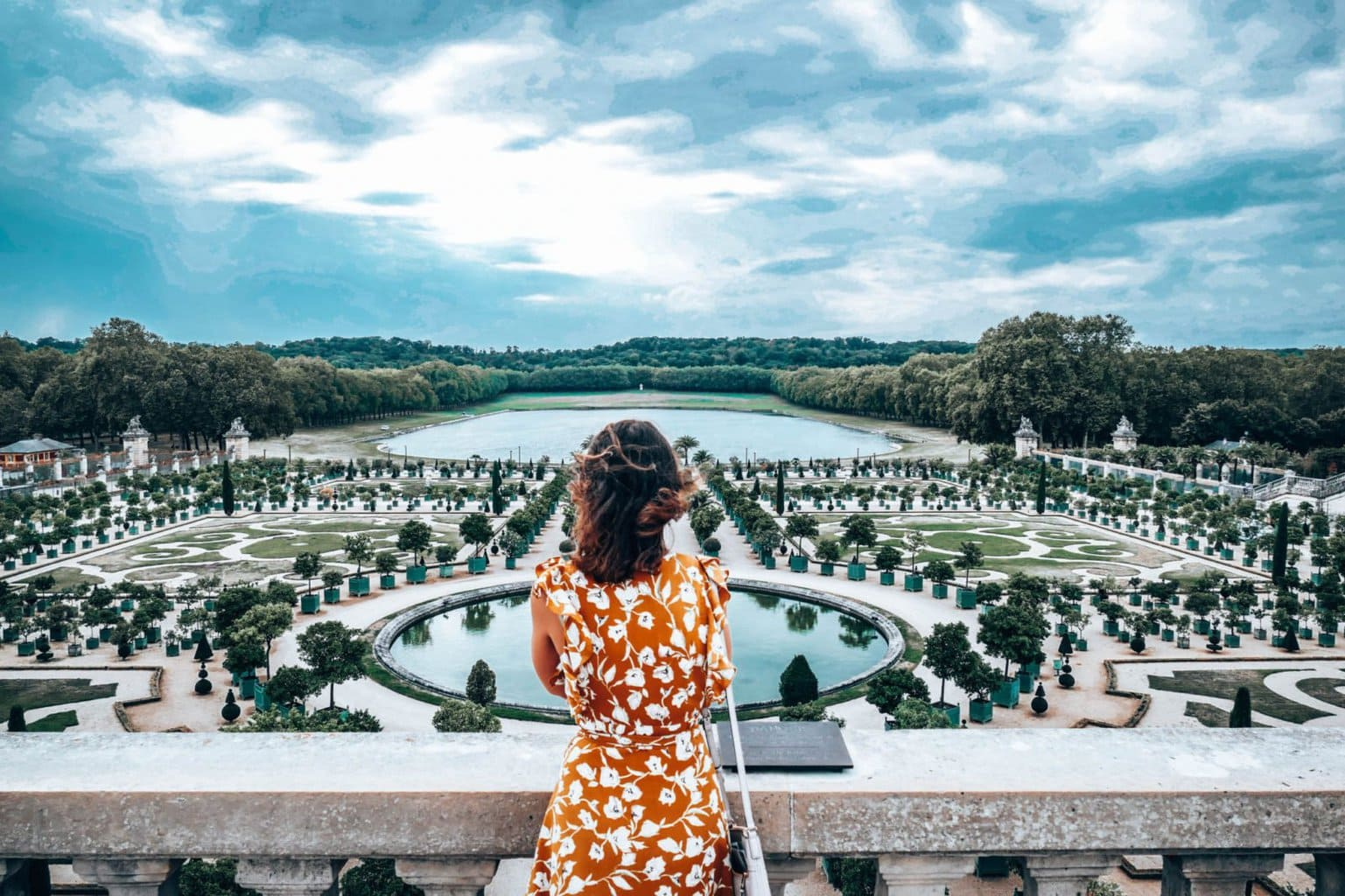 Lee looking out at gardens of Versailles