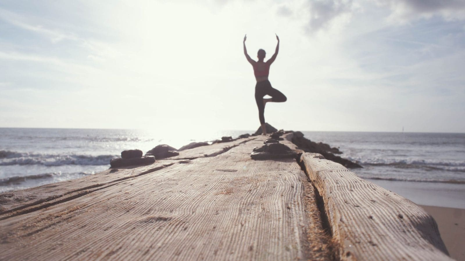 Yoga pose by the seaside