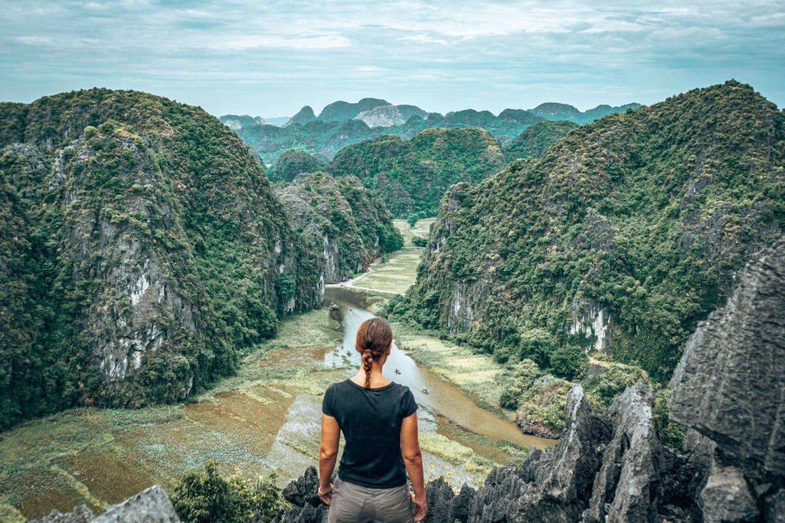 Picture of girl looking at the viewpoint from Hang Mua Cave in Tam Coc Vietnam