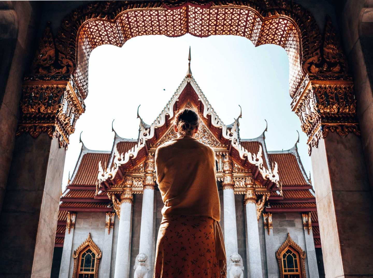 Picture of girl silhouetted against temple in Bangkok