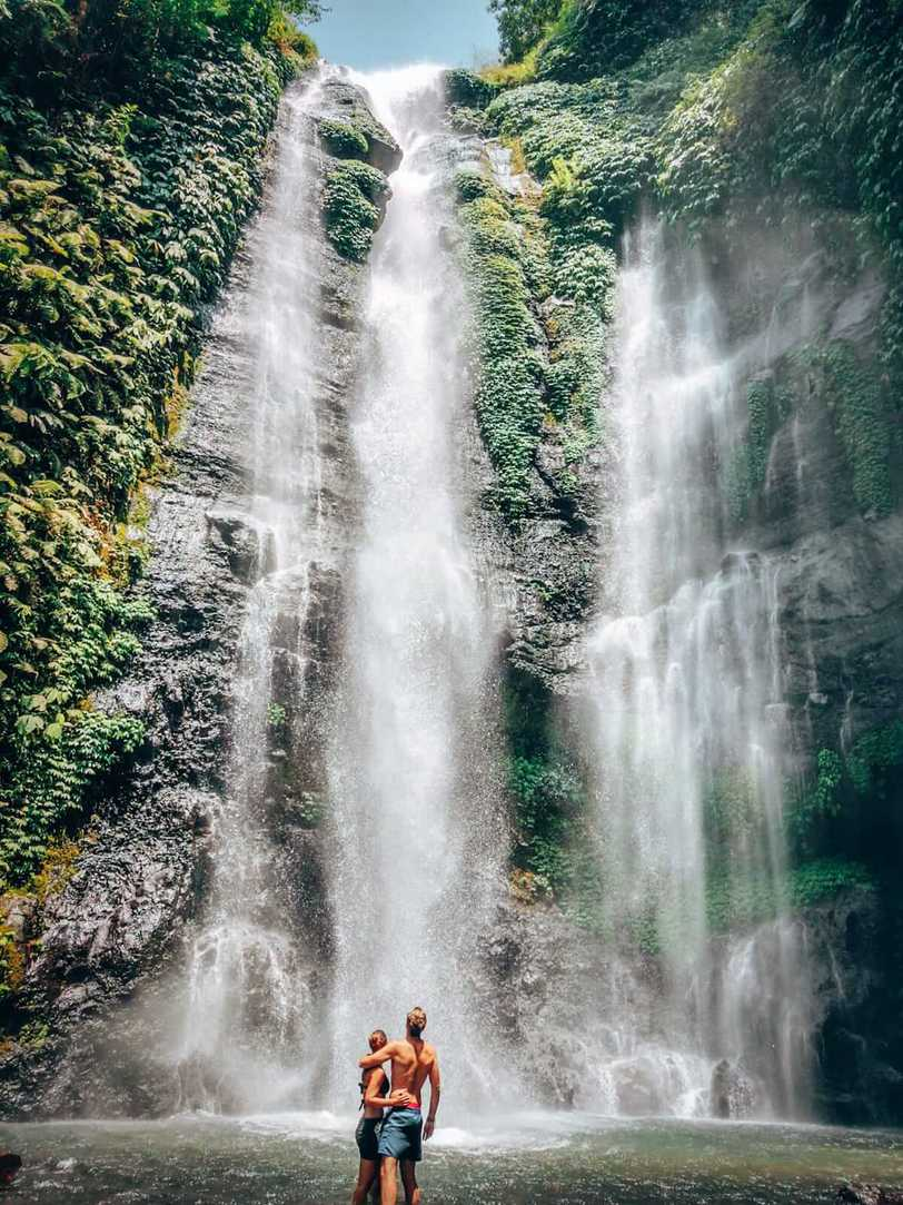 Sekumpul Waterfall - couple in the waterfall pool